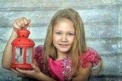 Mała blond dziewczyna w różowej sukni Obrazy Royalty Free