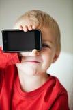 Mała chłopiec i odtwarzacz medialny Zdjęcia Royalty Free