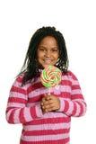Mała czarna dziewczyna z dużym lizakiem Obraz Royalty Free