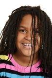 Mała czarna dziewczyna z włosy nad twarzą Obraz Royalty Free