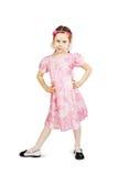 Mała dosyć niegrzeczna dziewczyna jest ubranym piękne menchie ubiera Fotografia Stock