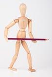 Mała drewniana mannequin pozycja z colour ołówkiem Obrazy Stock
