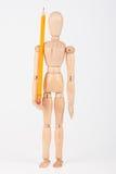 Mała drewniana mannequin pozycja z ołówkiem Fotografia Stock