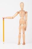 Mała drewniana mannequin pozycja z ołówkiem Zdjęcia Royalty Free