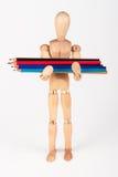 Mała drewniana mannequin pozycja z wiązką colour ołówka isolat Obrazy Royalty Free