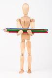Mała drewniana mannequin pozycja z wiązką colour ołówka isolat Fotografia Stock