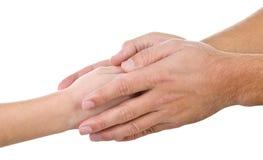 Mała dziecka ` s ręka w wielkich palmach dorosły Obrazy Stock
