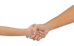 Mała dziecka ` s ręka w wielkiej palmie dorosły Obraz Royalty Free