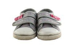Mała dziewczynka buty odizolowywający na białym tle obraz stock