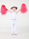 Mała dziewczynka chwyty w nastroszonych ręka pomponach Zdjęcie Royalty Free