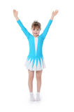 Mała dziewczynka gimnastyczka ćwiczy obrazy royalty free