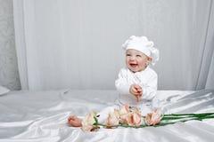 Mała dziewczynka i kwiaty Zdjęcie Royalty Free