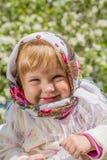 Mała dziewczynka ono uśmiecha się w miękkim tle Zdjęcie Stock