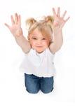 Mała dziewczynka pokazuje ona ręki Obrazy Stock