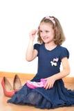 Mała dziewczynka pozuje podczas gdy robić up Fotografia Stock