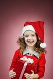 mała dziewczynka prezenta otwarty czerwony pudełko Zdjęcia Stock