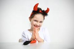 Mała dziewczynka ubierająca jak Fotografia Stock