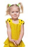 Mała dziewczynka w żółtej sukni Zdjęcia Stock