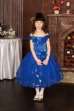 Mała dziewczynka w błękit sukni Fotografia Stock