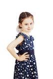 Mała dziewczynka w błękitnej sukni z polek kropkami fotografia stock