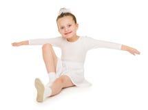 Mała dziewczynka w białej balowej todze Fotografia Stock