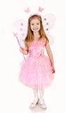 Mała dziewczynka w czarodziejskim kostiumu na bielu Zdjęcie Stock