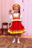 Mała dziewczynka w czerwonej Rosyjskiej obywatel sukni obraz royalty free