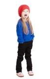 Mała dziewczynka w nakrętki czerwonych uśmiechach zdjęcia royalty free