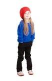 Mała dziewczynka w nakrętki czerwonych uśmiechach obrazy stock