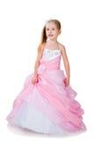 Mała dziewczynka w wspaniałej todze na biel Zdjęcia Royalty Free