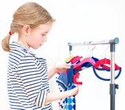 Mała dziewczynka wybiera suknię Obraz Royalty Free