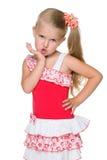Mała dziewczynka wysyła lotniczego buziaka fotografia royalty free
