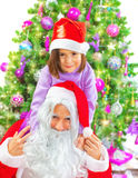 Mała dziewczynka z Święty Mikołaj Zdjęcie Stock