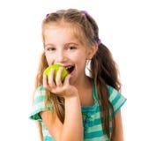 Mała dziewczynka z jabłkami Zdjęcia Royalty Free