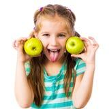 Mała dziewczynka z jabłkami Fotografia Stock
