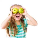Mała dziewczynka z jabłkami Zdjęcia Stock