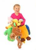 Mała dziewczynka z jej ulubionymi zabawkami Zdjęcie Stock