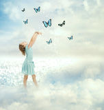 Mała Dziewczynka z motylami Fotografia Stock