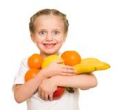 Mała dziewczynka z naręcze owoc Zdjęcie Royalty Free