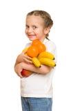 Mała dziewczynka z naręcze owoc Obraz Royalty Free