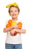 Mała dziewczynka z naręcze owoc Fotografia Stock