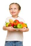 Mała dziewczynka z owoc i warzywo na bielu Obraz Royalty Free