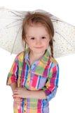 Mała dziewczynka z parasolem. Odizolowywający na a zdjęcia royalty free