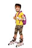 Mała dziewczynka z rolkowymi łyżwami Obrazy Royalty Free