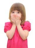 Mała dziewczynka z zakrywał jego usta obraz royalty free