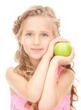 Mała dziewczynka z zielonym jabłkiem Fotografia Royalty Free