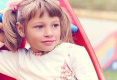 Mała Kaukaska dziecko dziewczyna patrzeje poważnie być na boisku zdjęcie royalty free