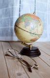 Mała kula ziemska i szkła Fotografia Stock