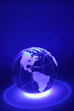 Mała kula ziemska jest iluminuje światłem spod spodu Obraz Royalty Free