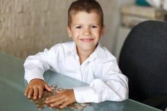 Mała milioner chłopiec zdjęcie royalty free